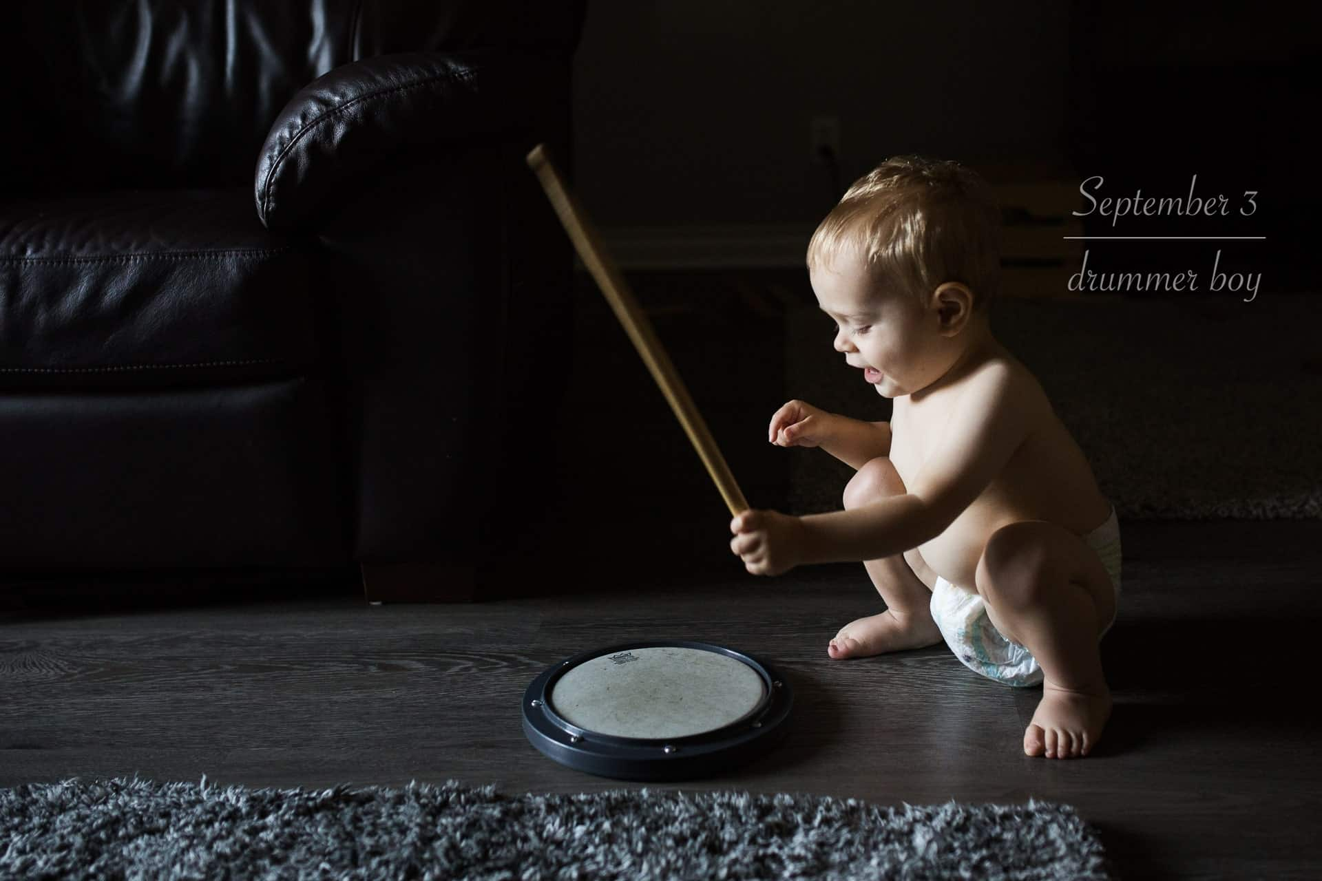 toddler boy in diaper playing the drums