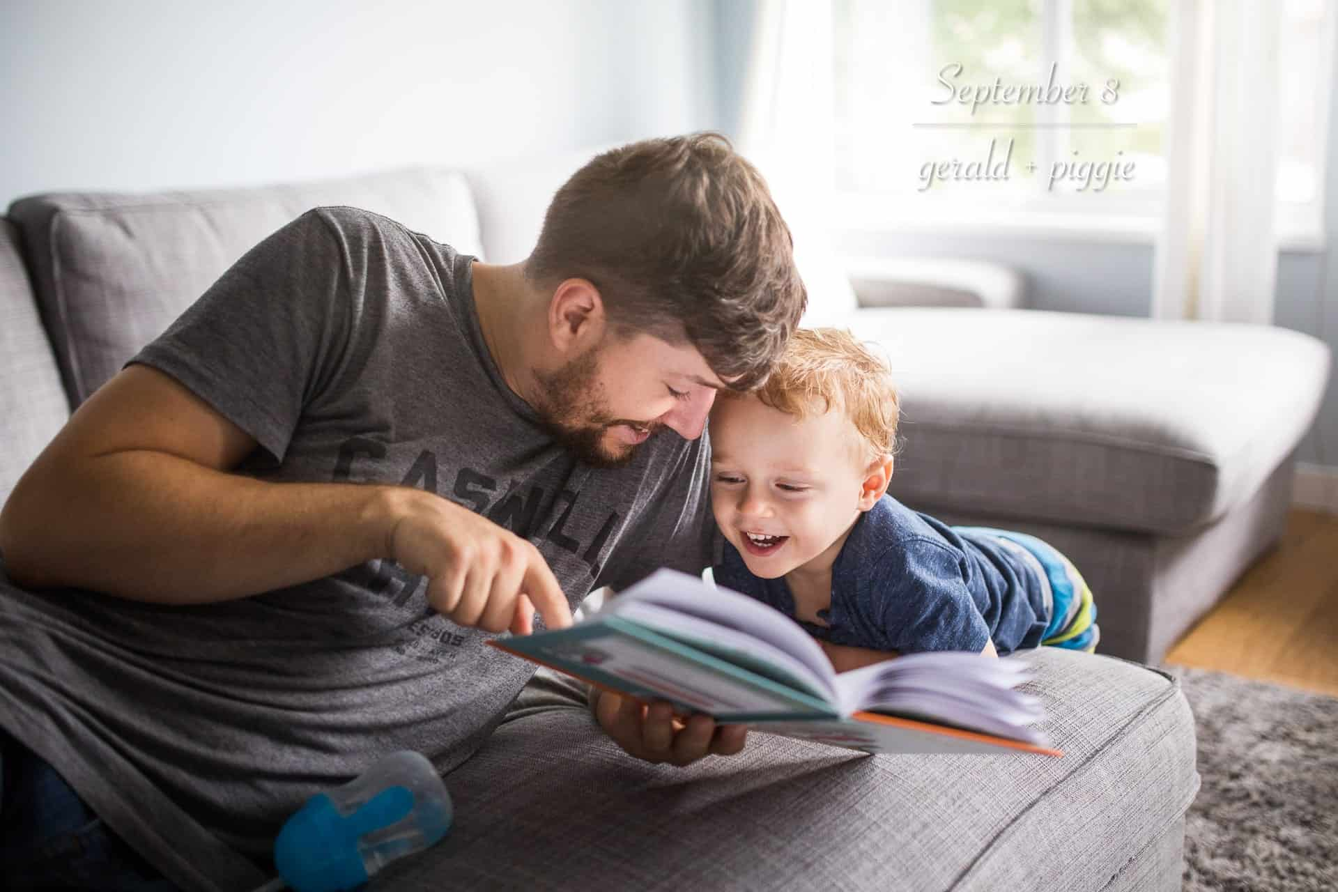 dad reading to toddler son