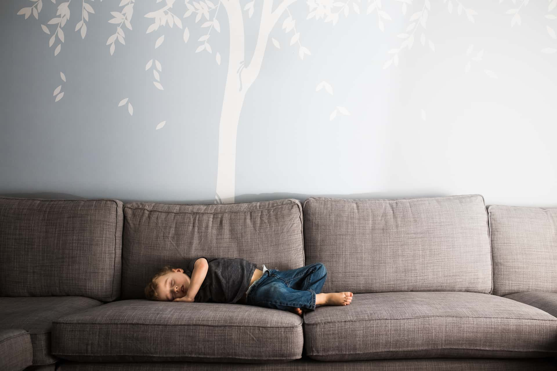 toddler boy asleep on the couch