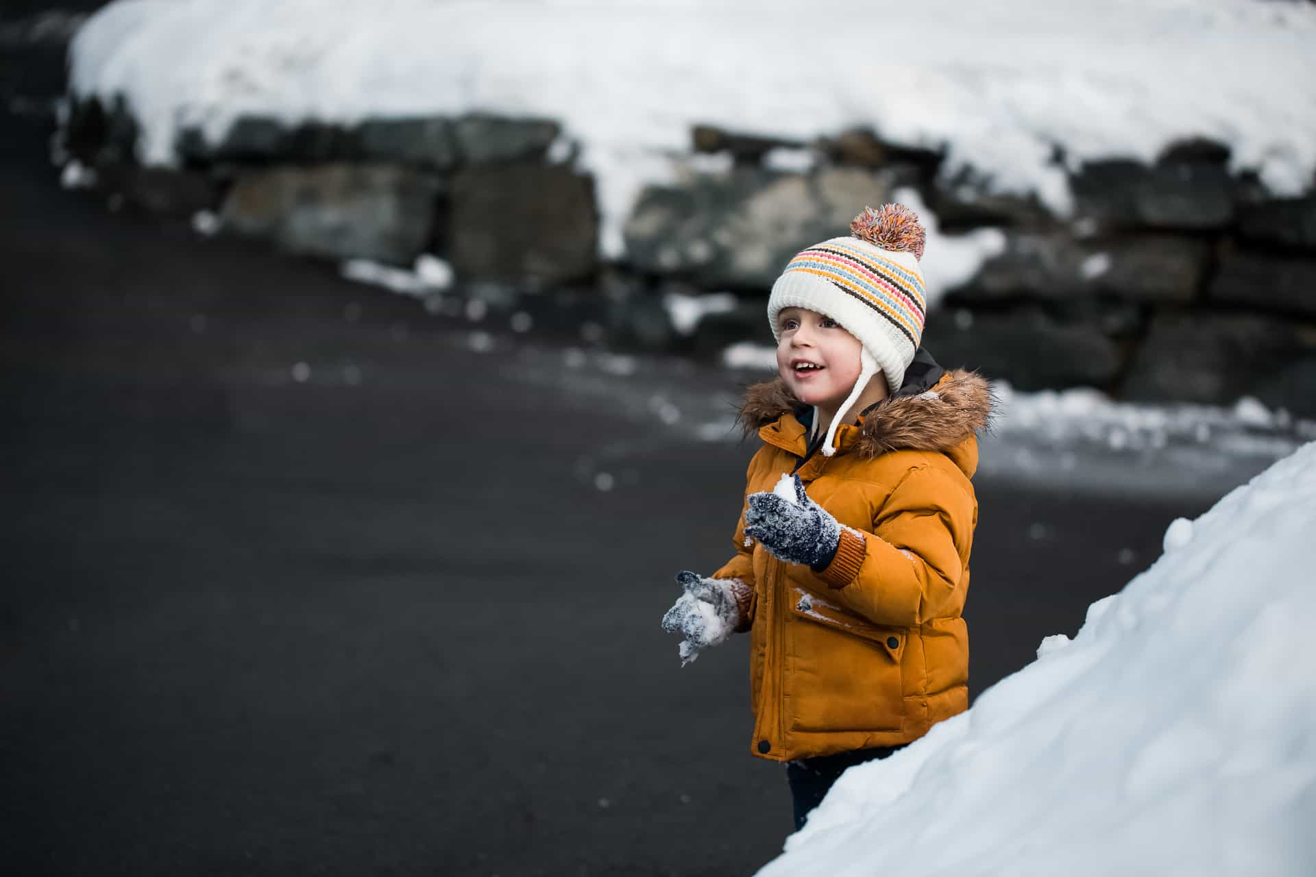 toddler boy eating snow
