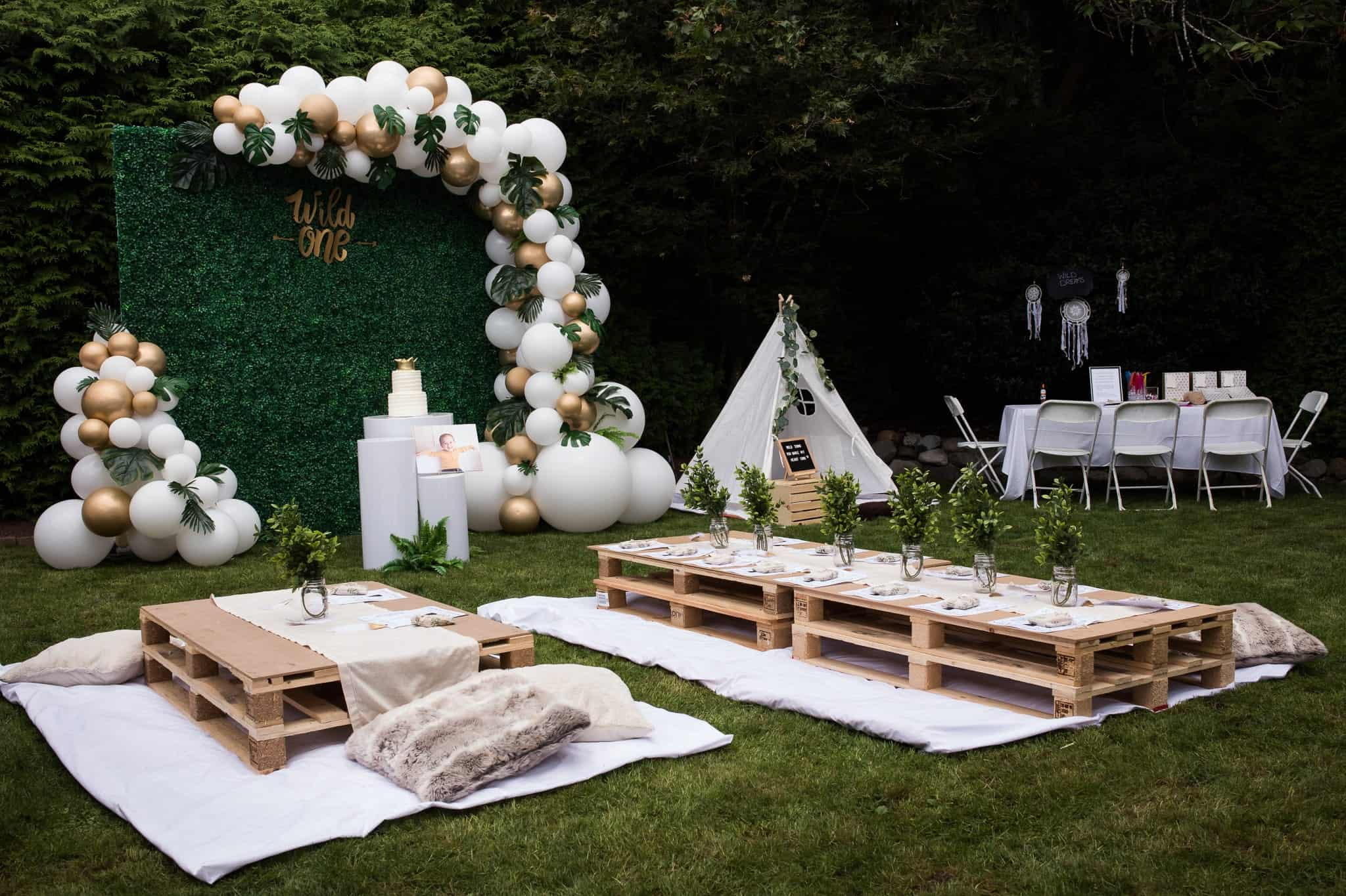 backyard decorated for first birthday party