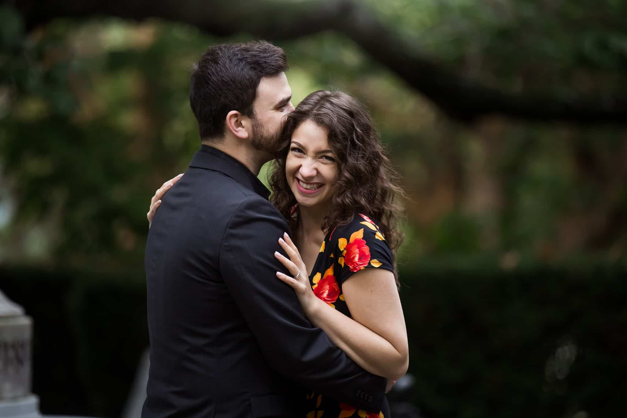 couple hugging and woman laughing