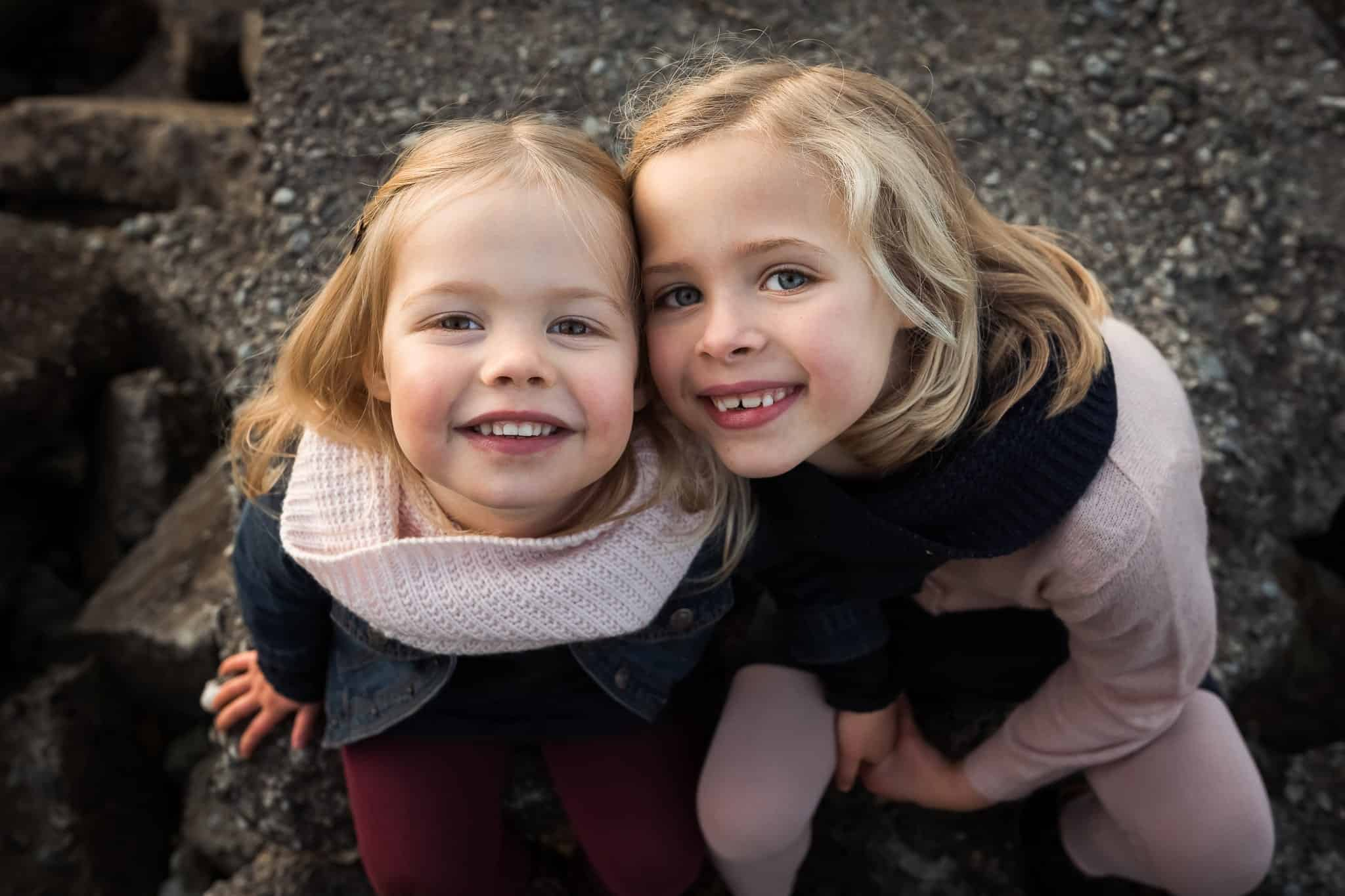 two little girls cheek to cheek