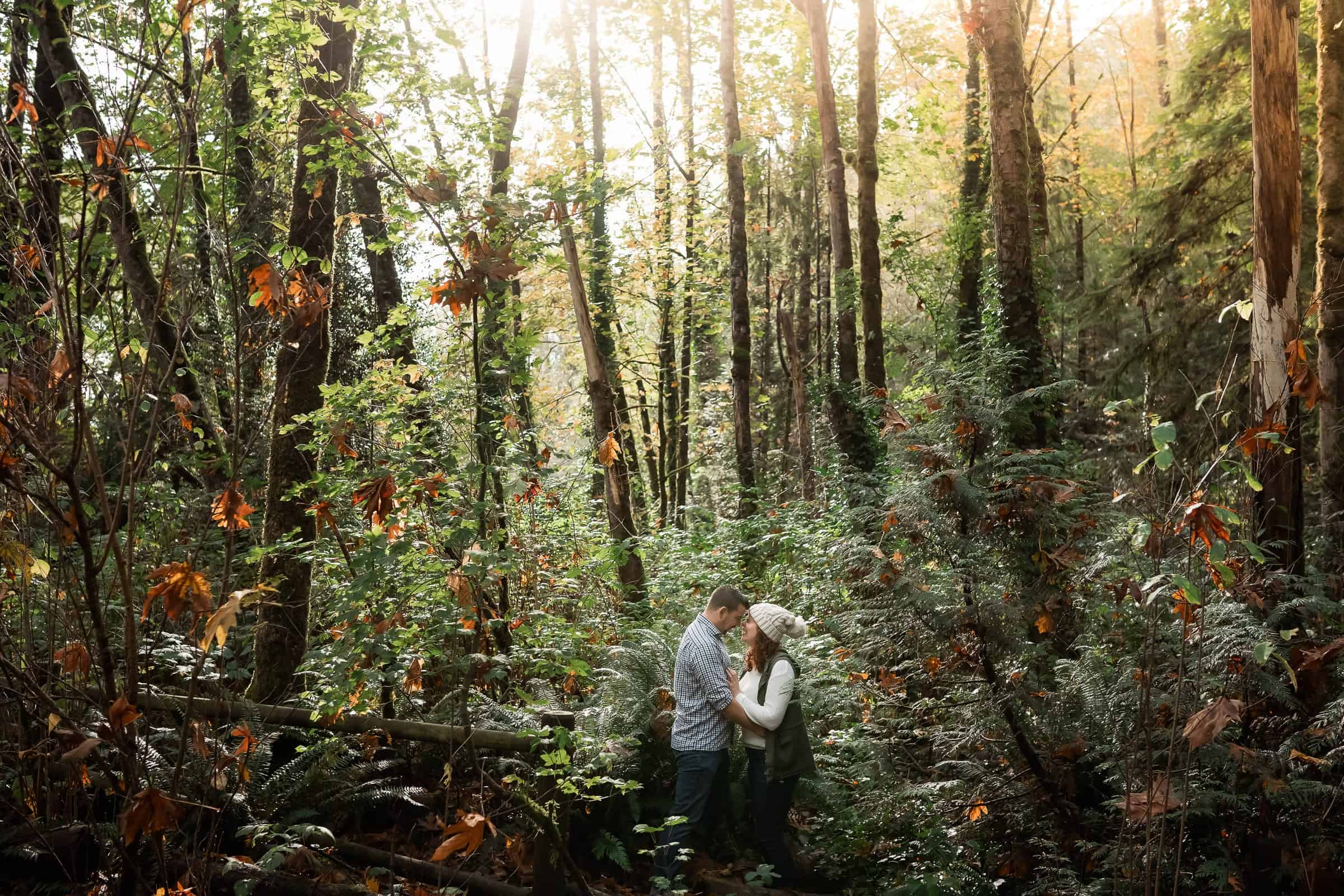 couple laughing together in deep autumn foliage