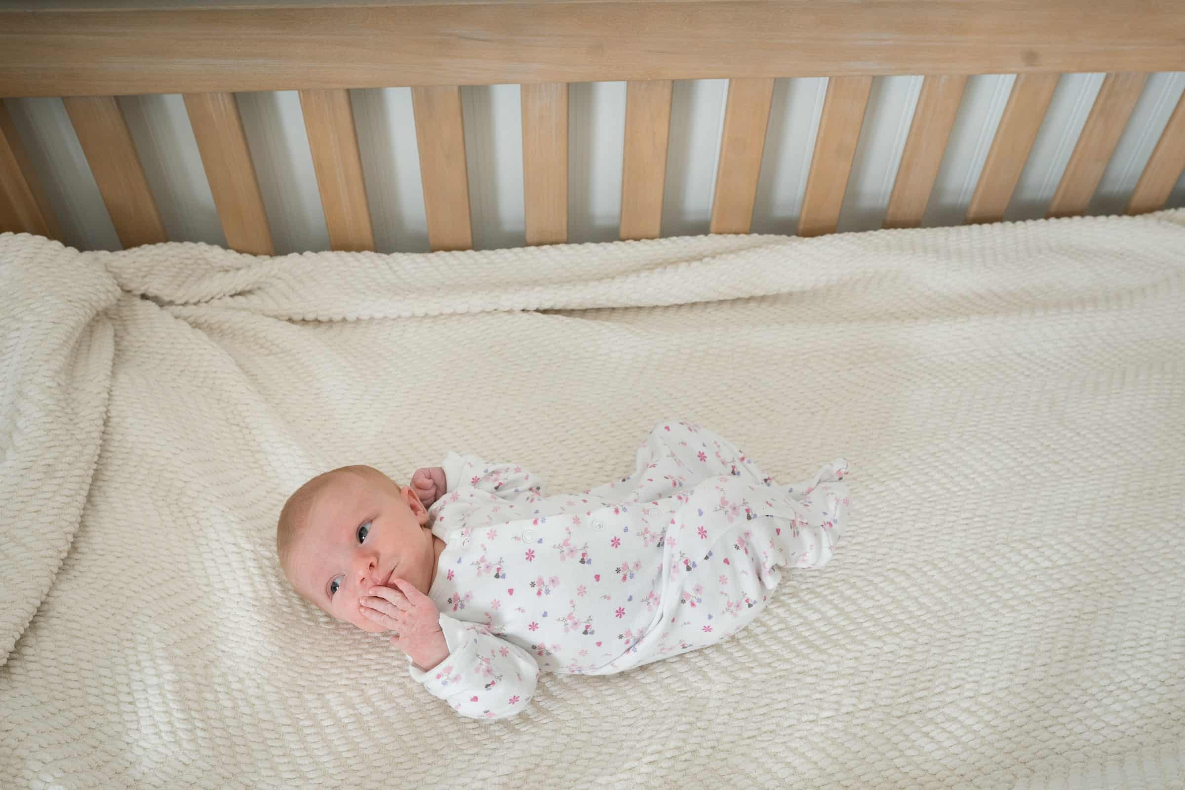 baby laying in crib awake