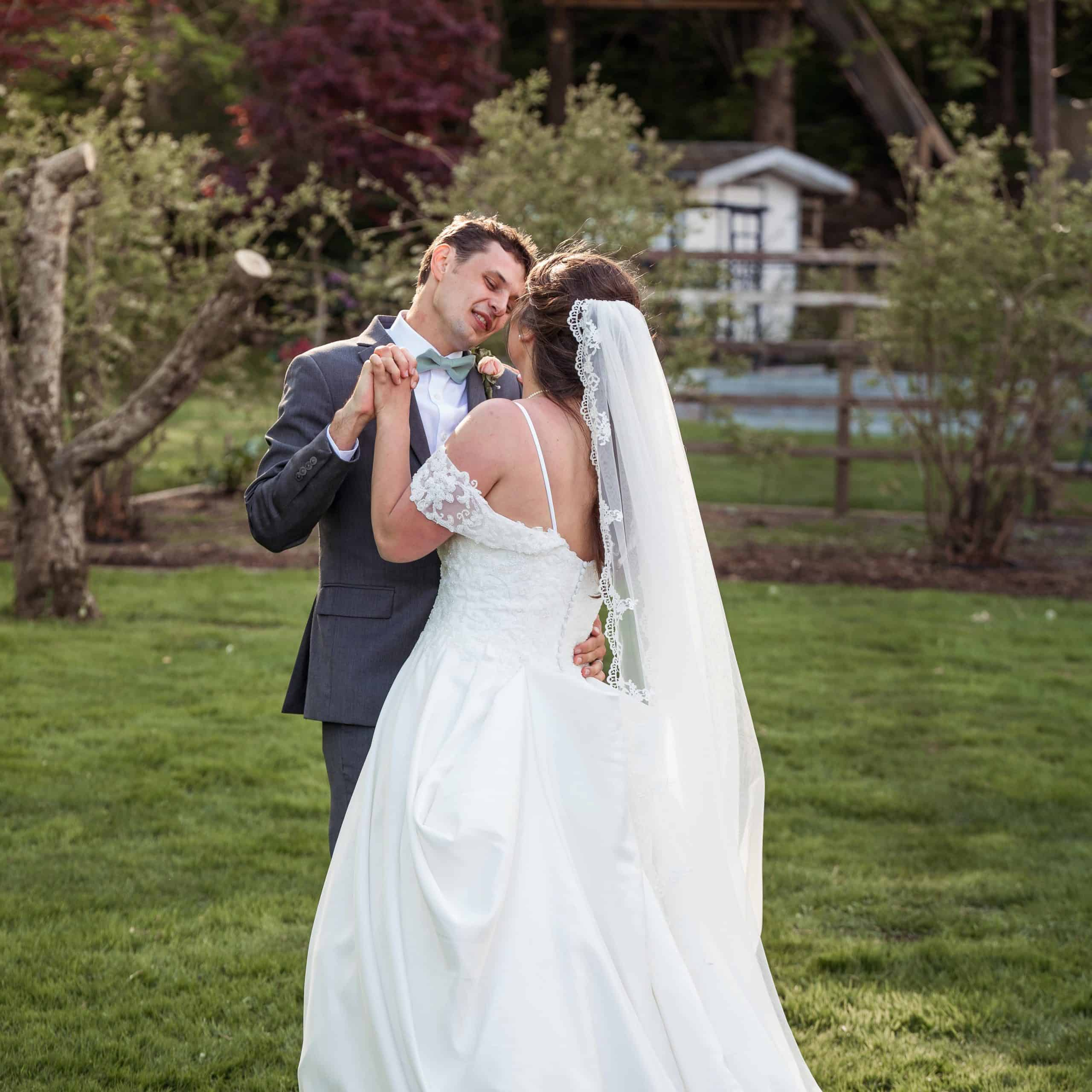 bride and groom dancing in yard