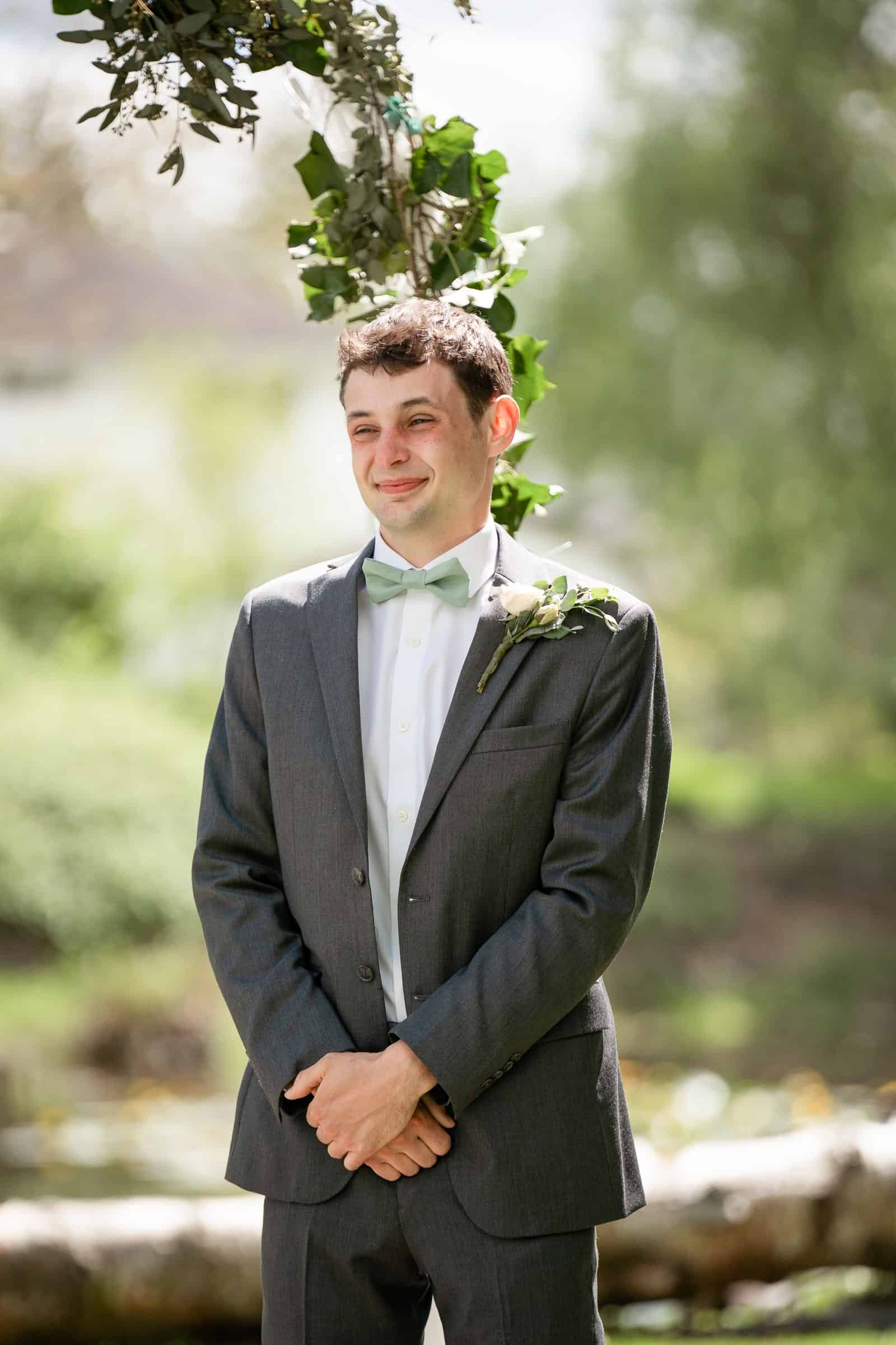 emotional groom watching bride come down aisle