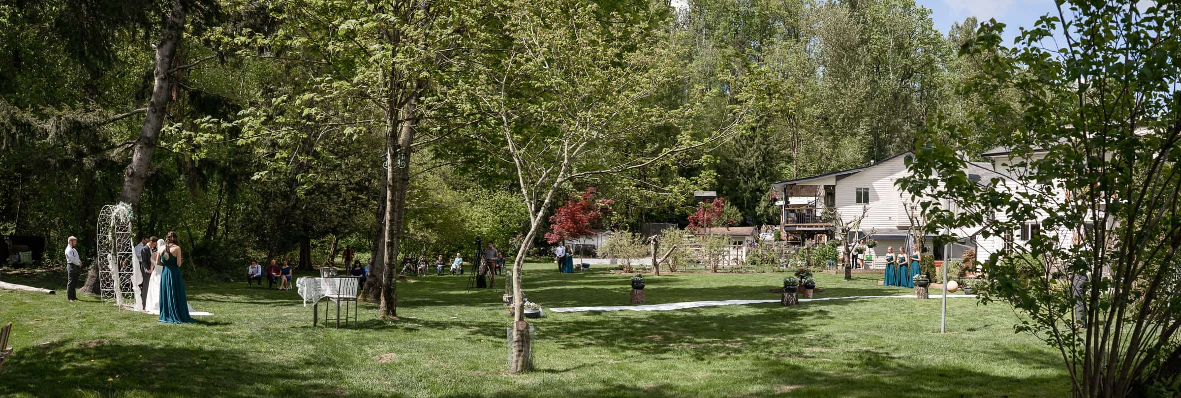 panorama of backyard socially distanced covid wedding