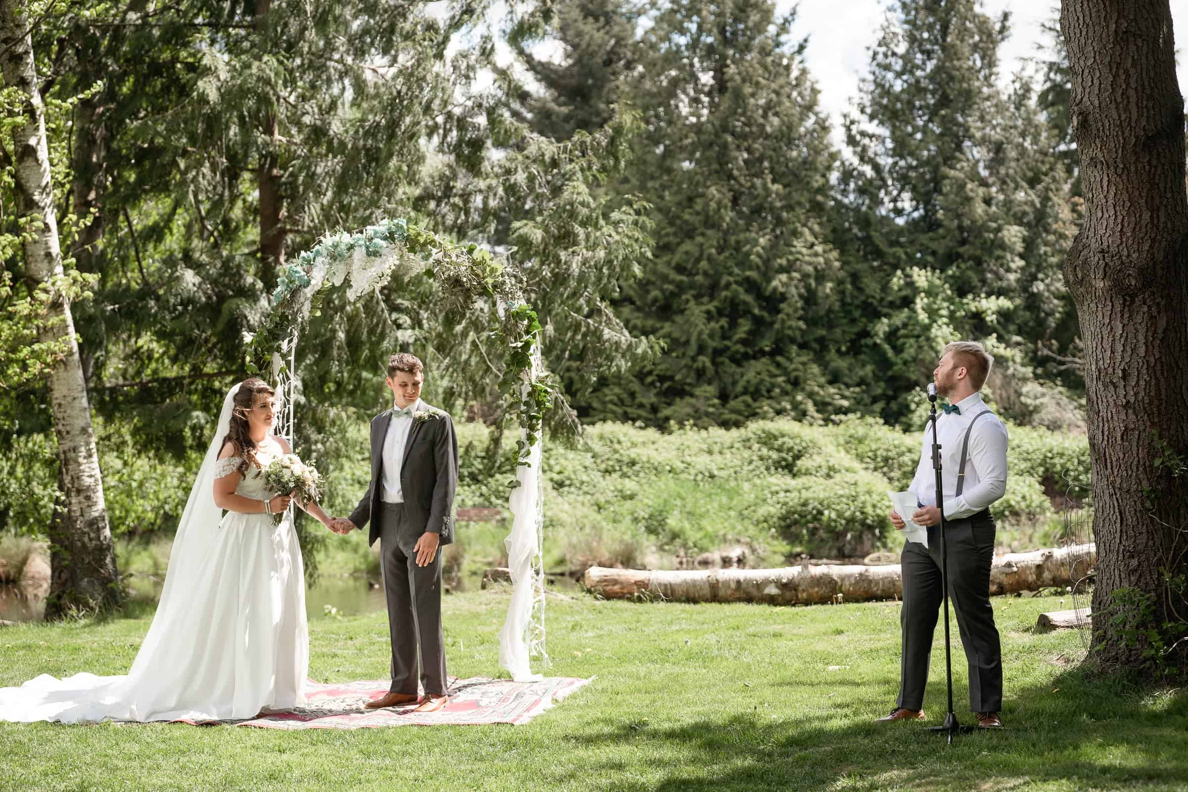 best man reading speech to bride and groom at ceremony