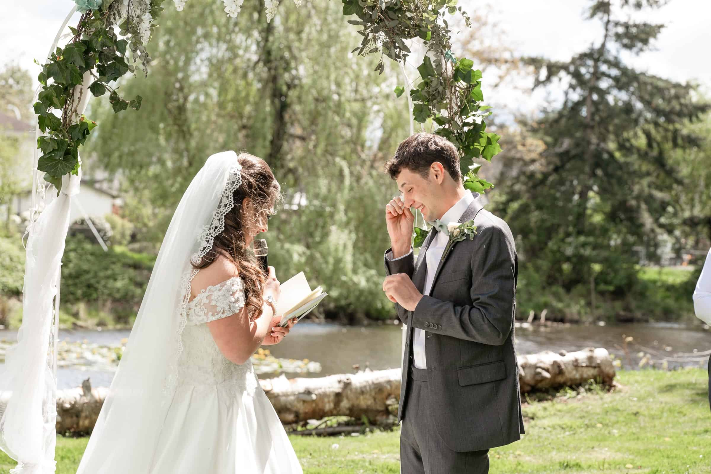 groom crying as bride reads vows