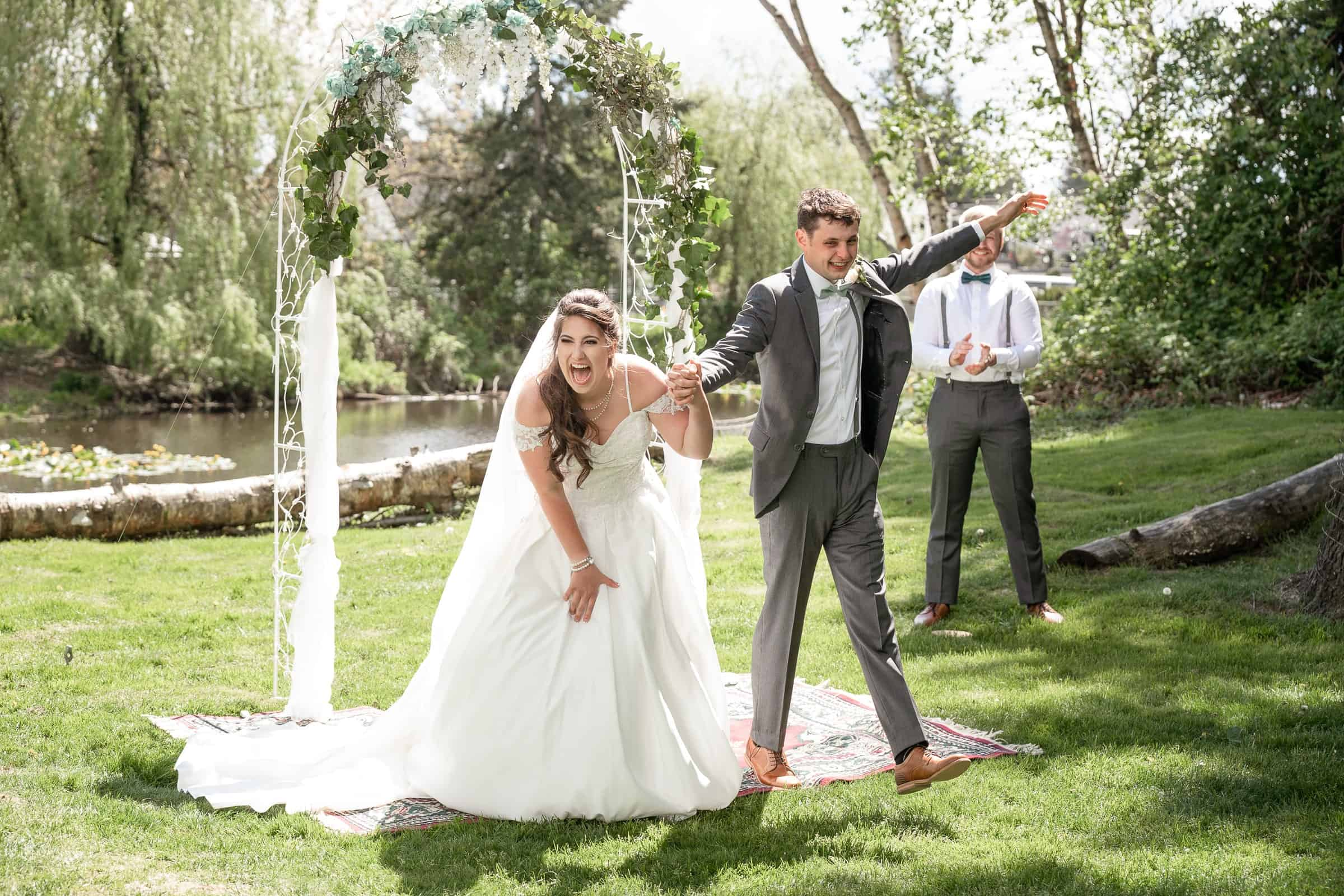 bride and groom celebrating being made man and wife