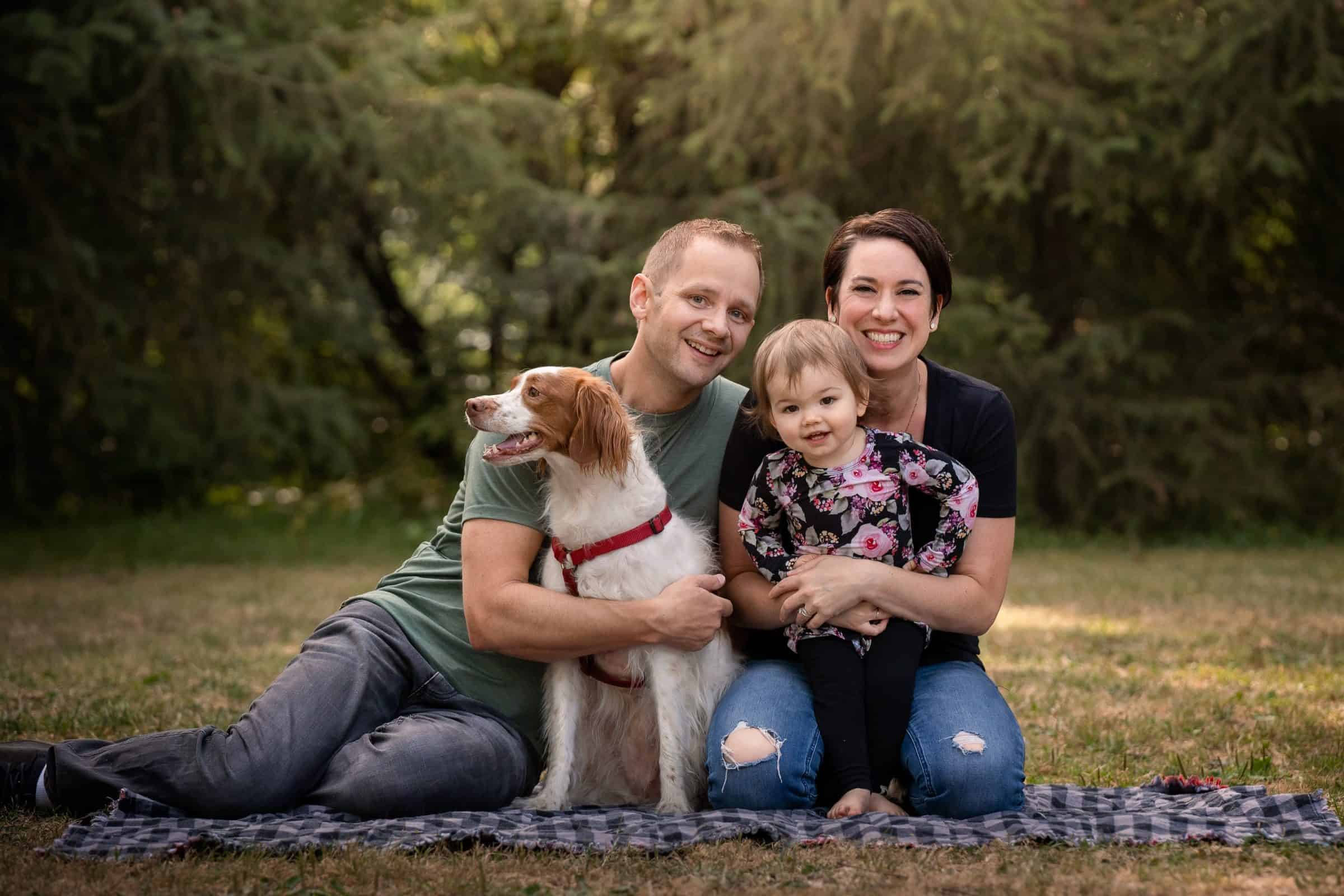 family photo on blanket with dog