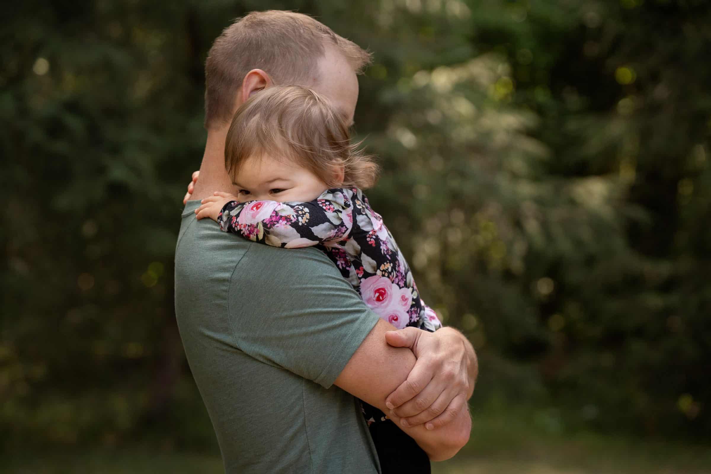 dad hugging toddler girl