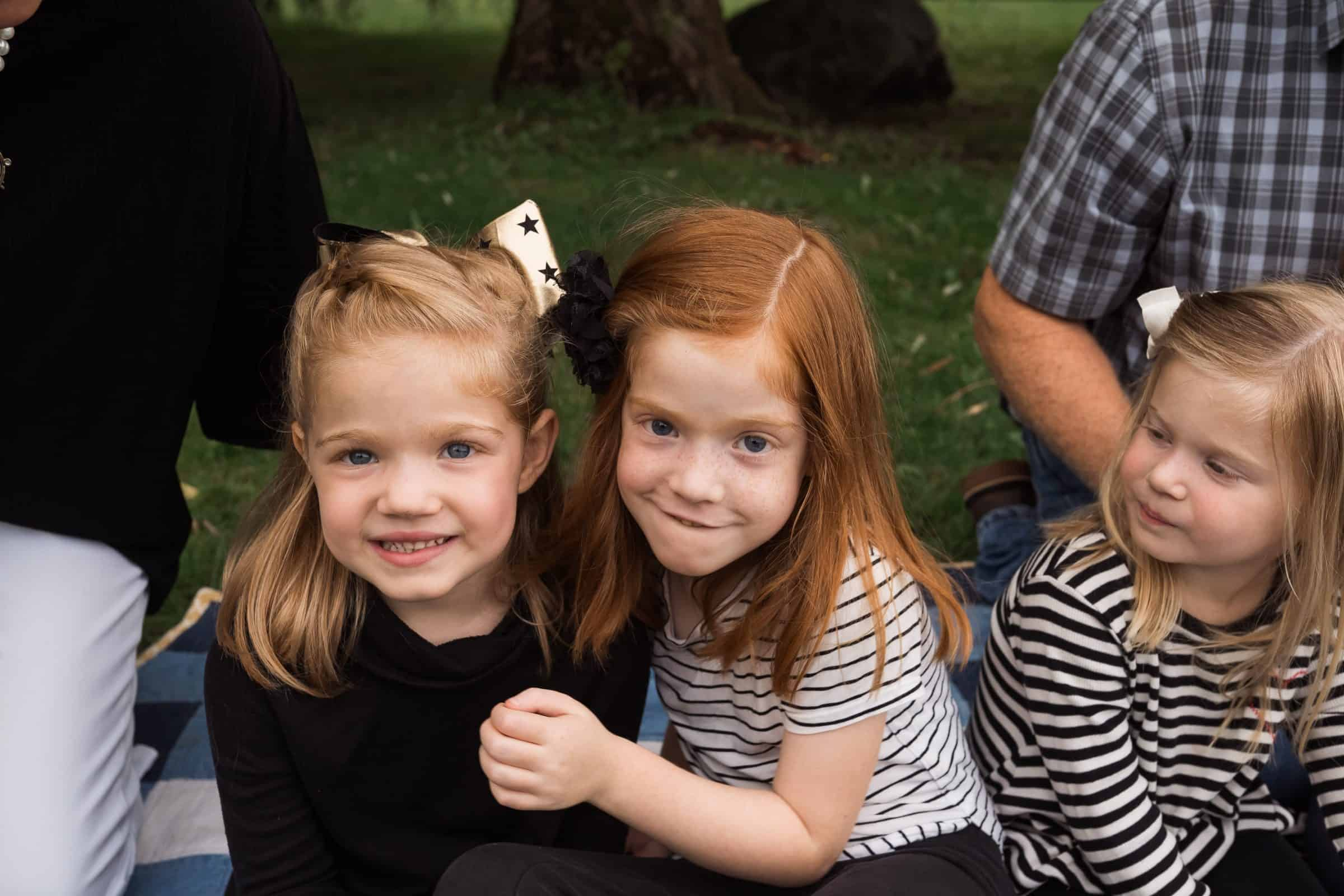 close up of two red-haired siblings smiling for the camera