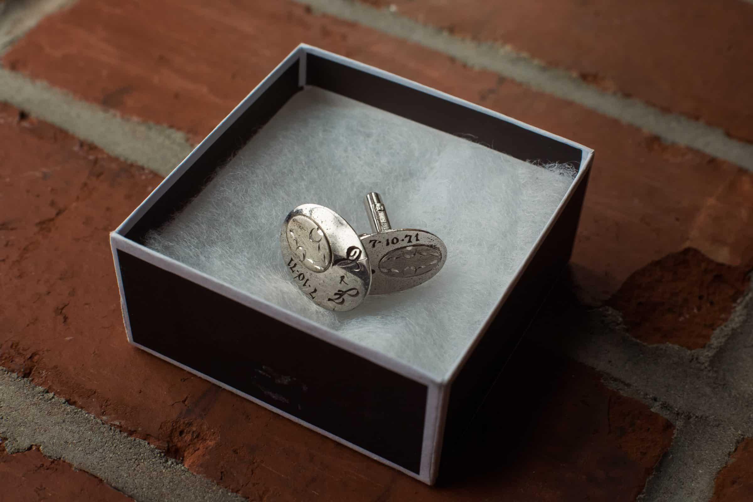 close up of cufflinks in box