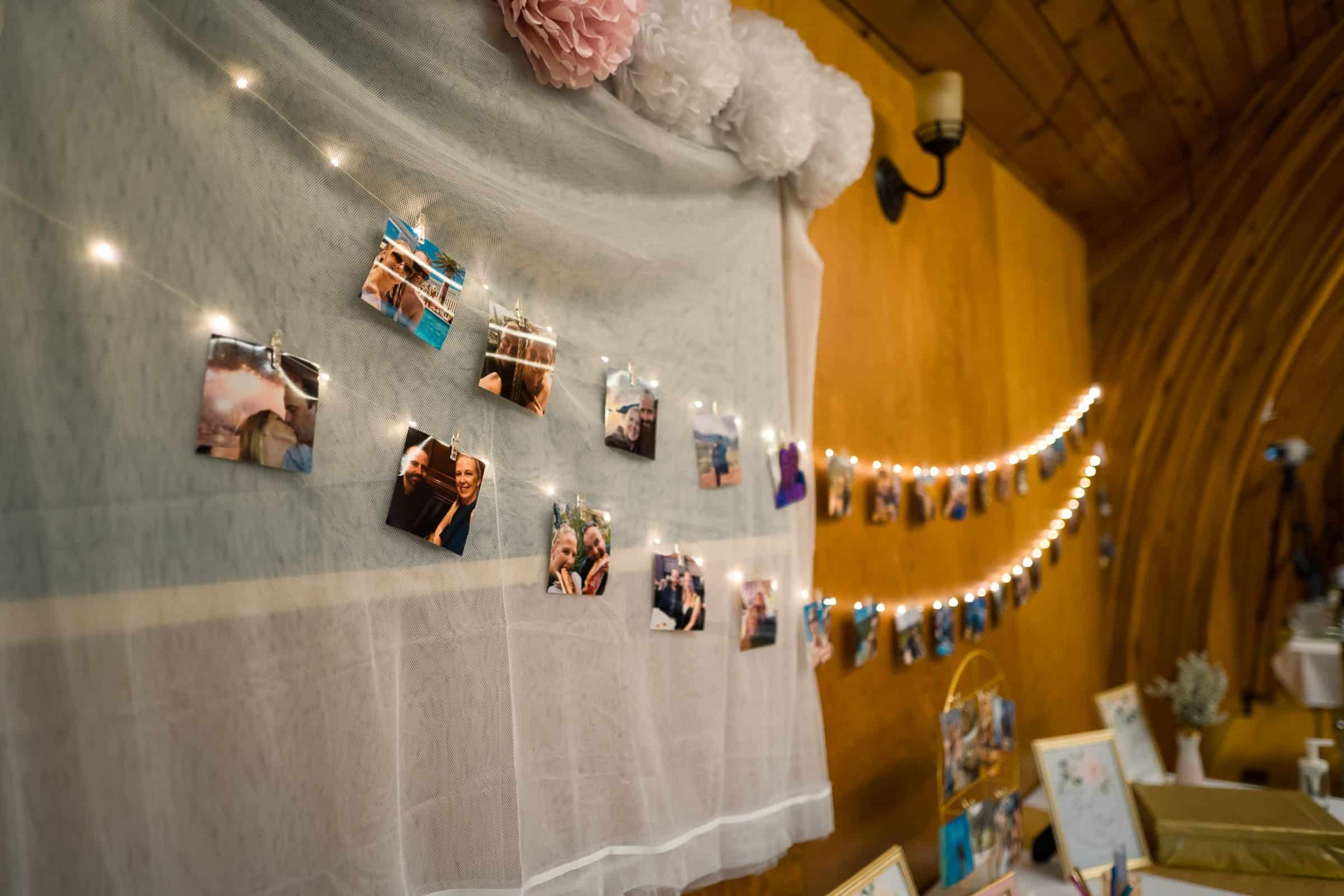 close up of pictures hung by strung lights in wedding hall