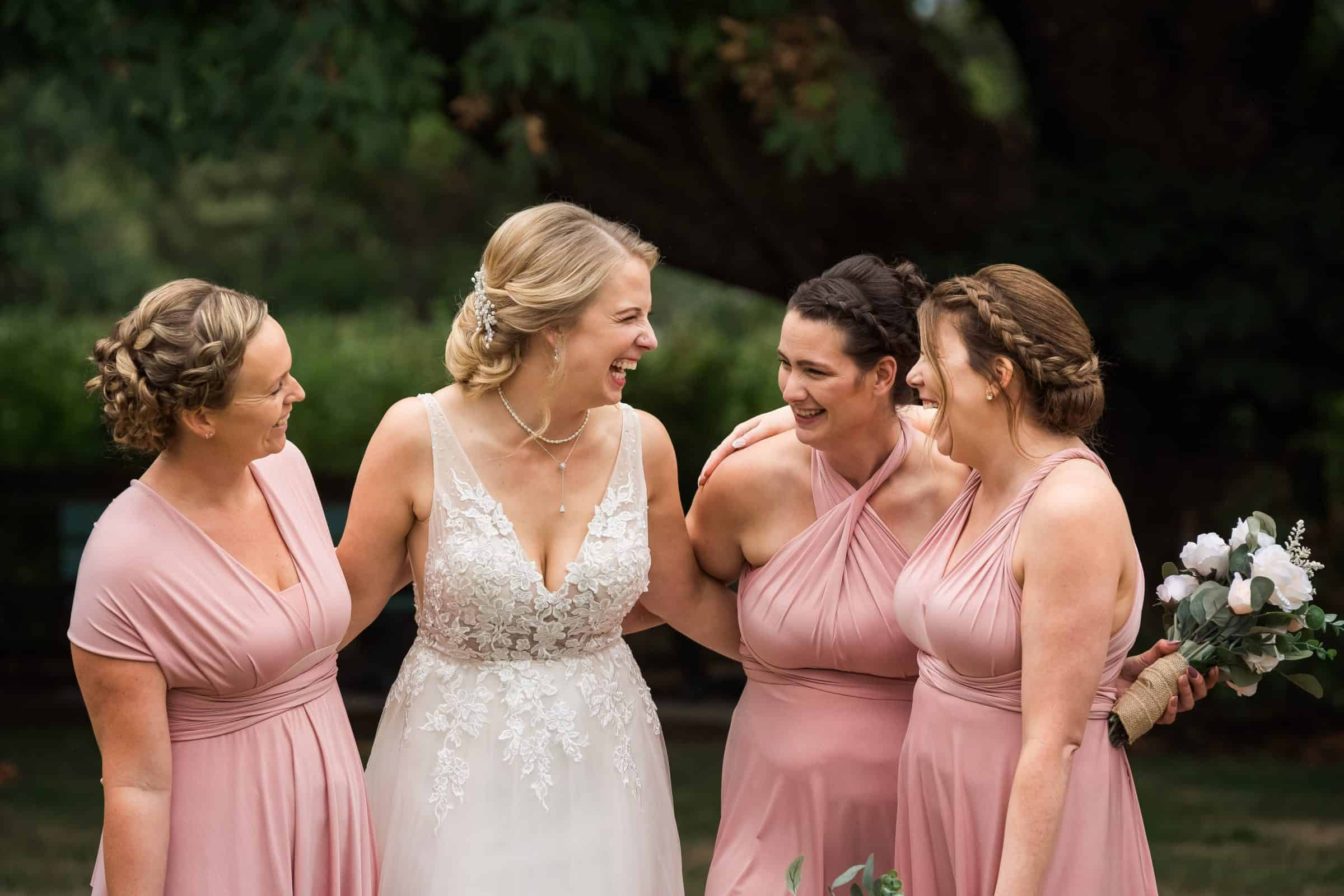 bridal party girls hugging and laughing together