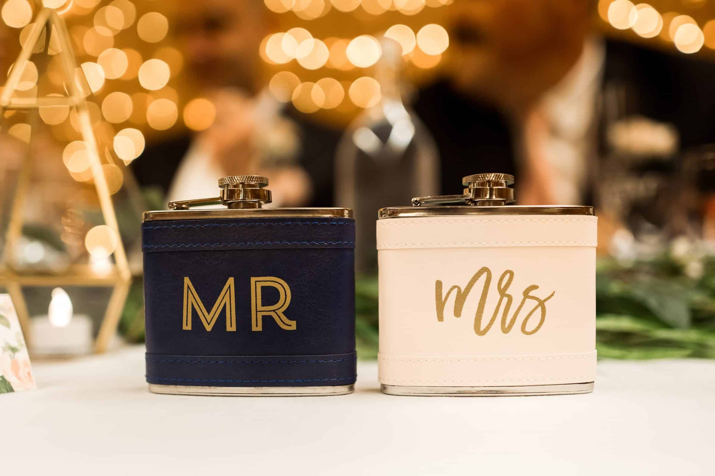 """close up of """"mr"""" and """"mrs"""" flasks with light bokeh in background"""