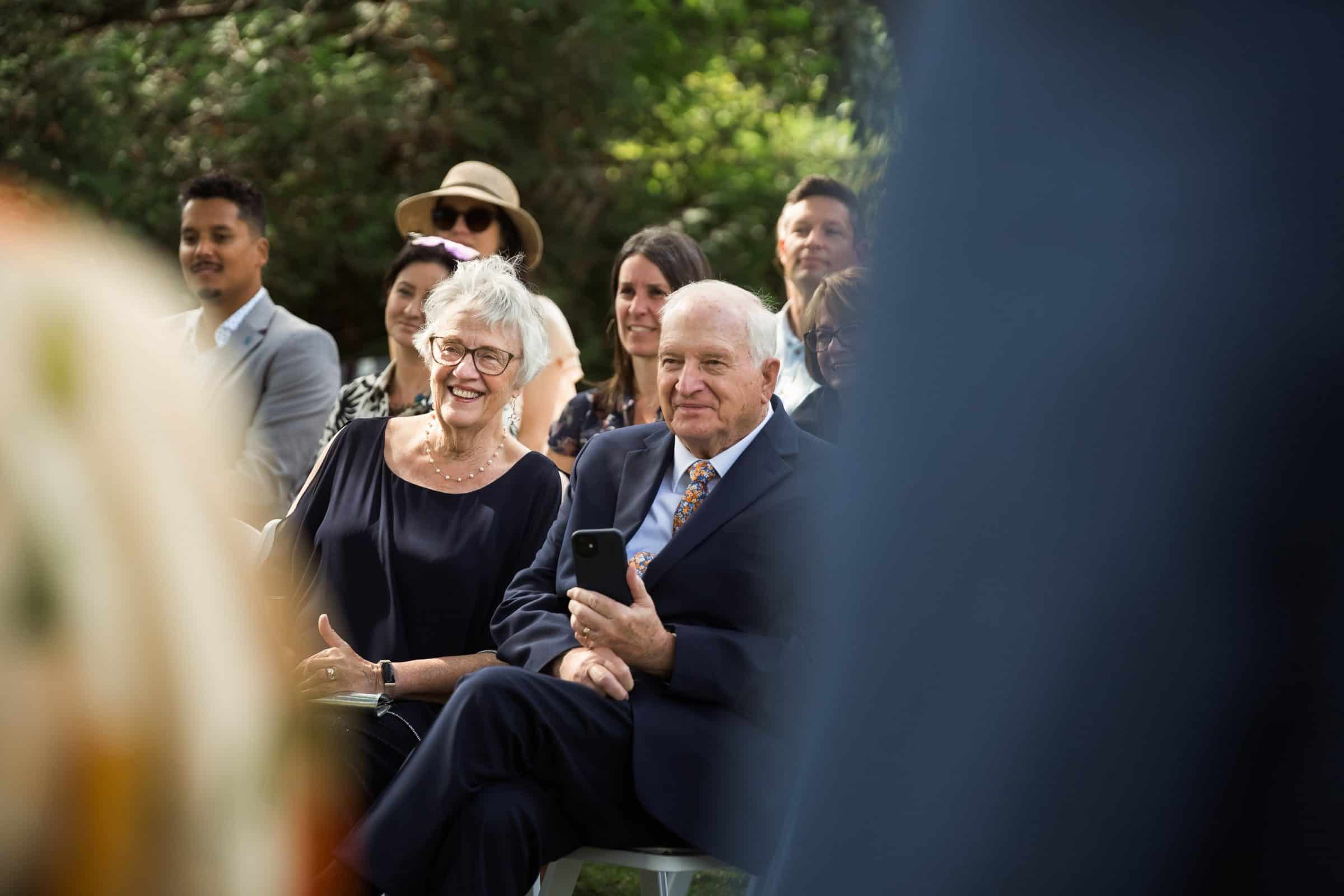 close up of parents at wedding smiling
