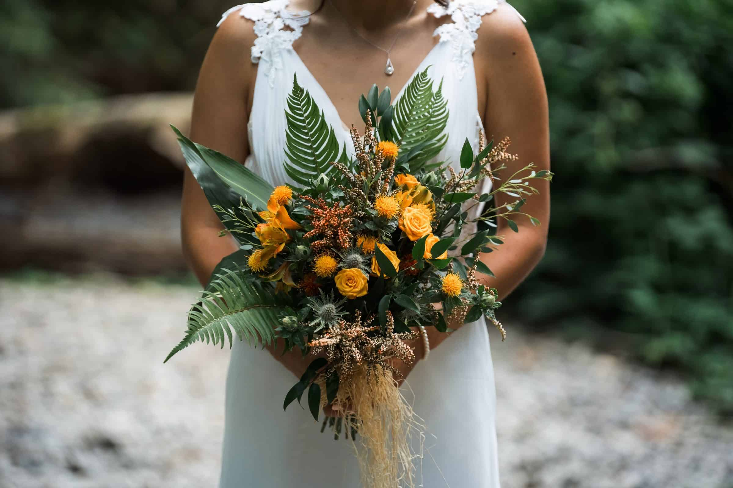 close up of bride holding her bouquet