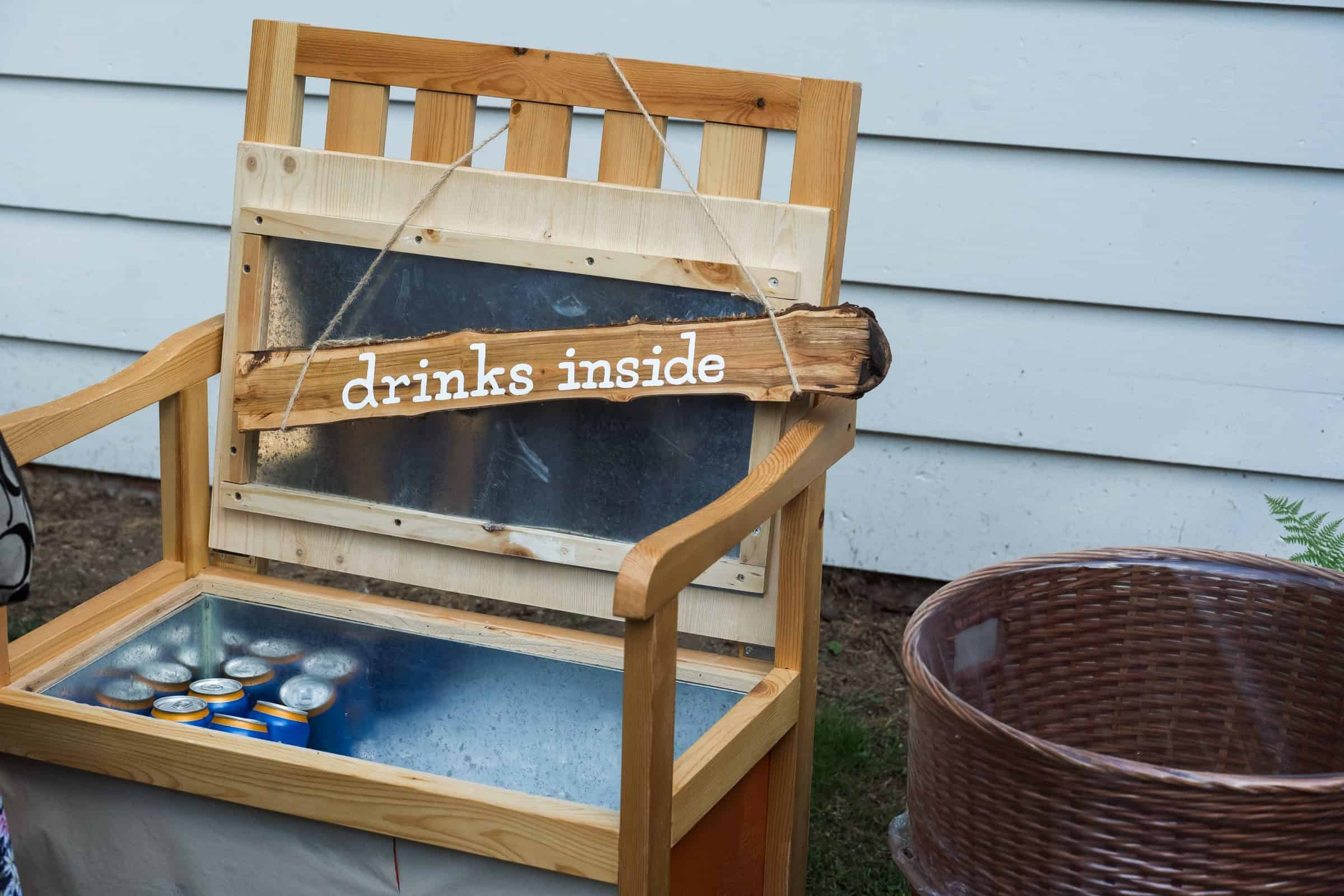 close up of custom made drink sign and bench at wedding reception