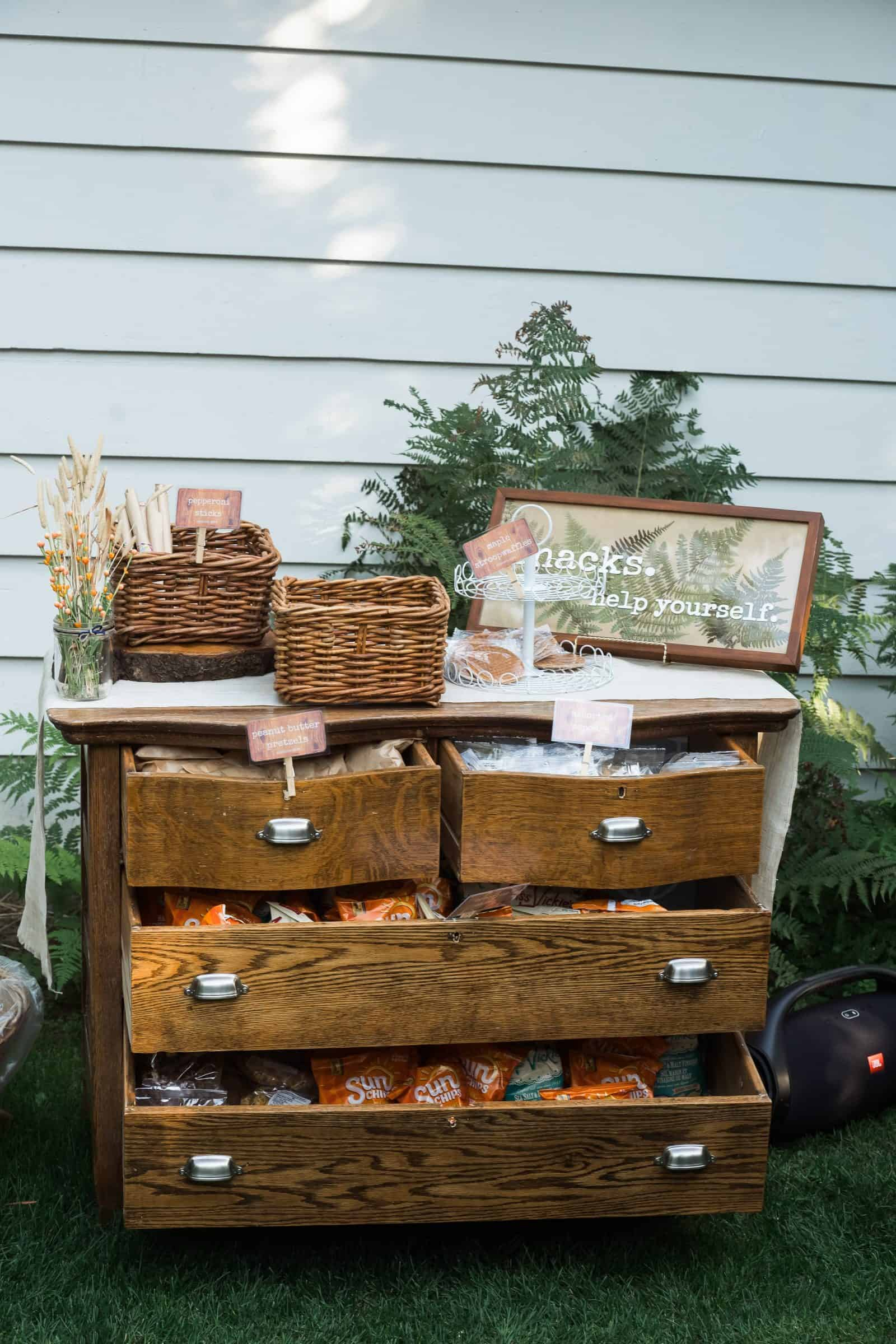chest of drawers used as a snack station at wedding
