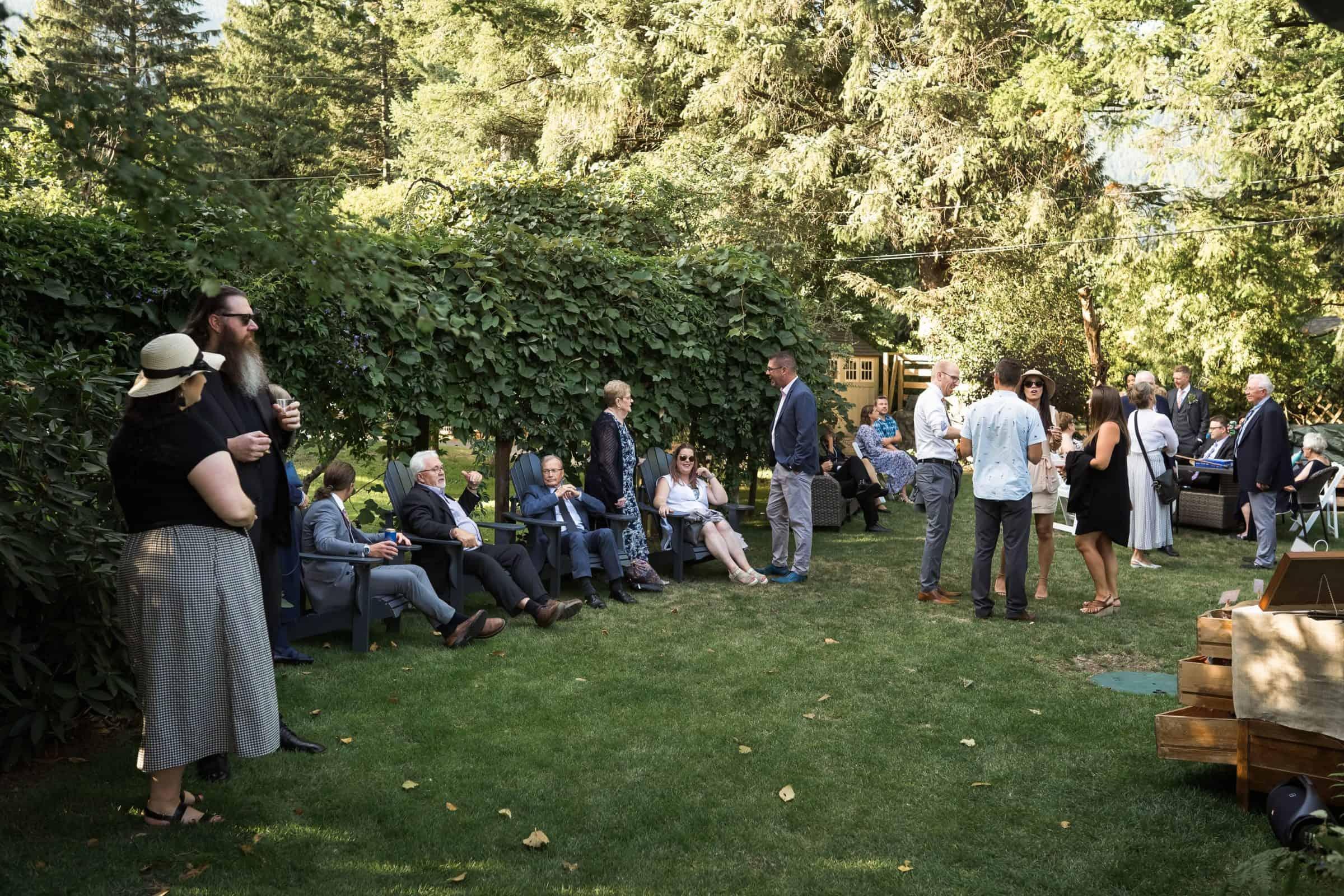 people mingling in backyard during wedding