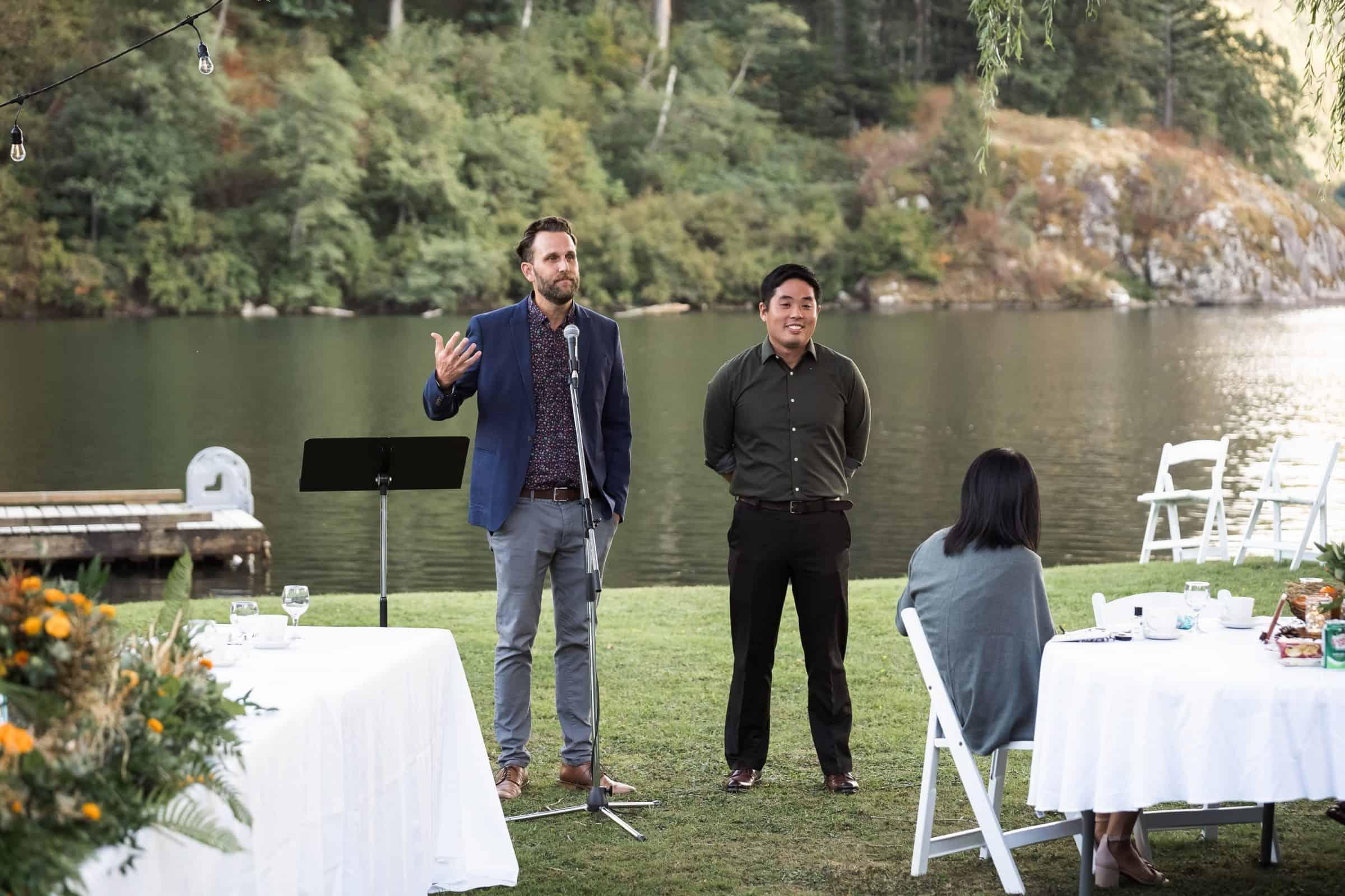 two men standing up to MC a backyard wedding