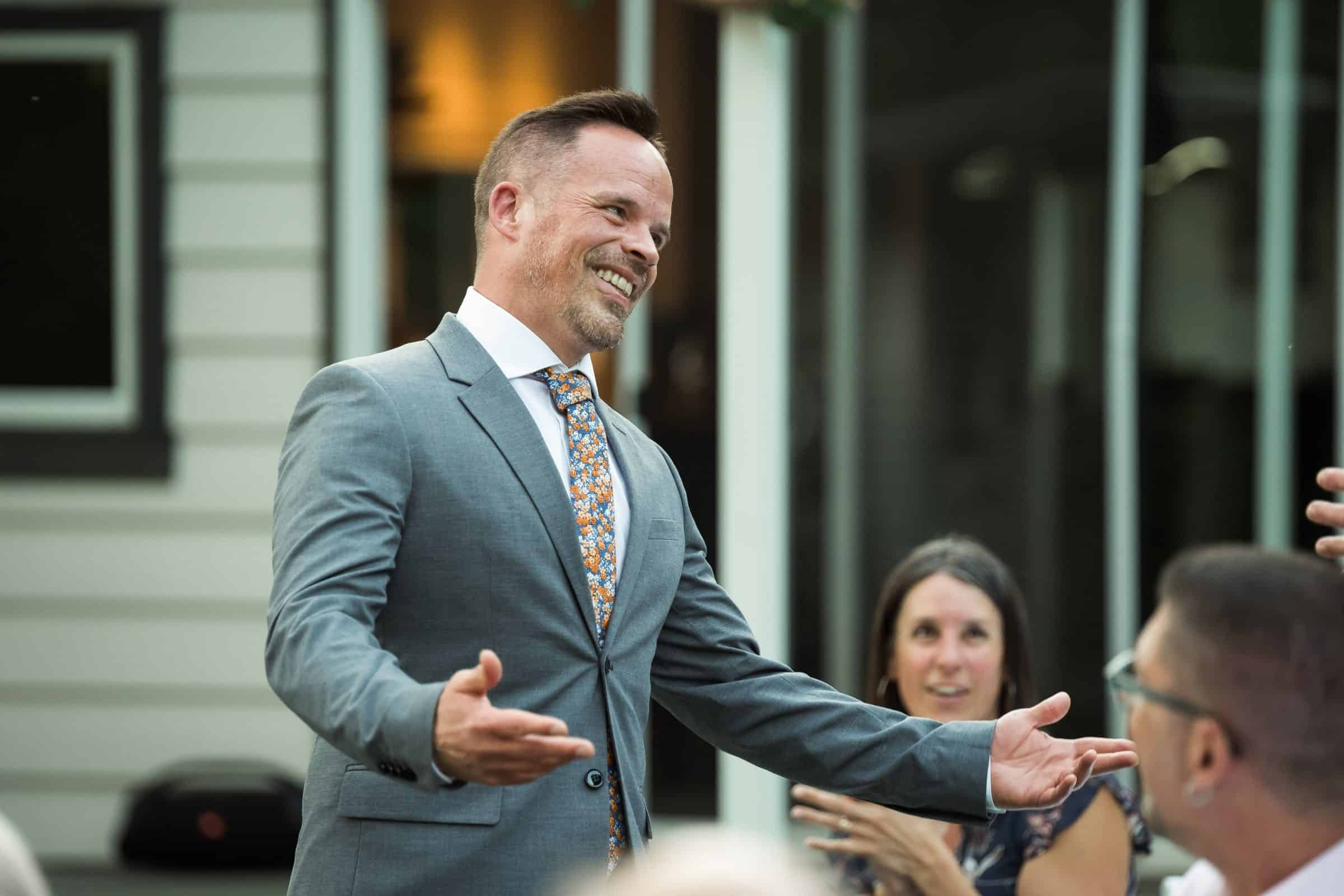 groomsman laughing and gesturing