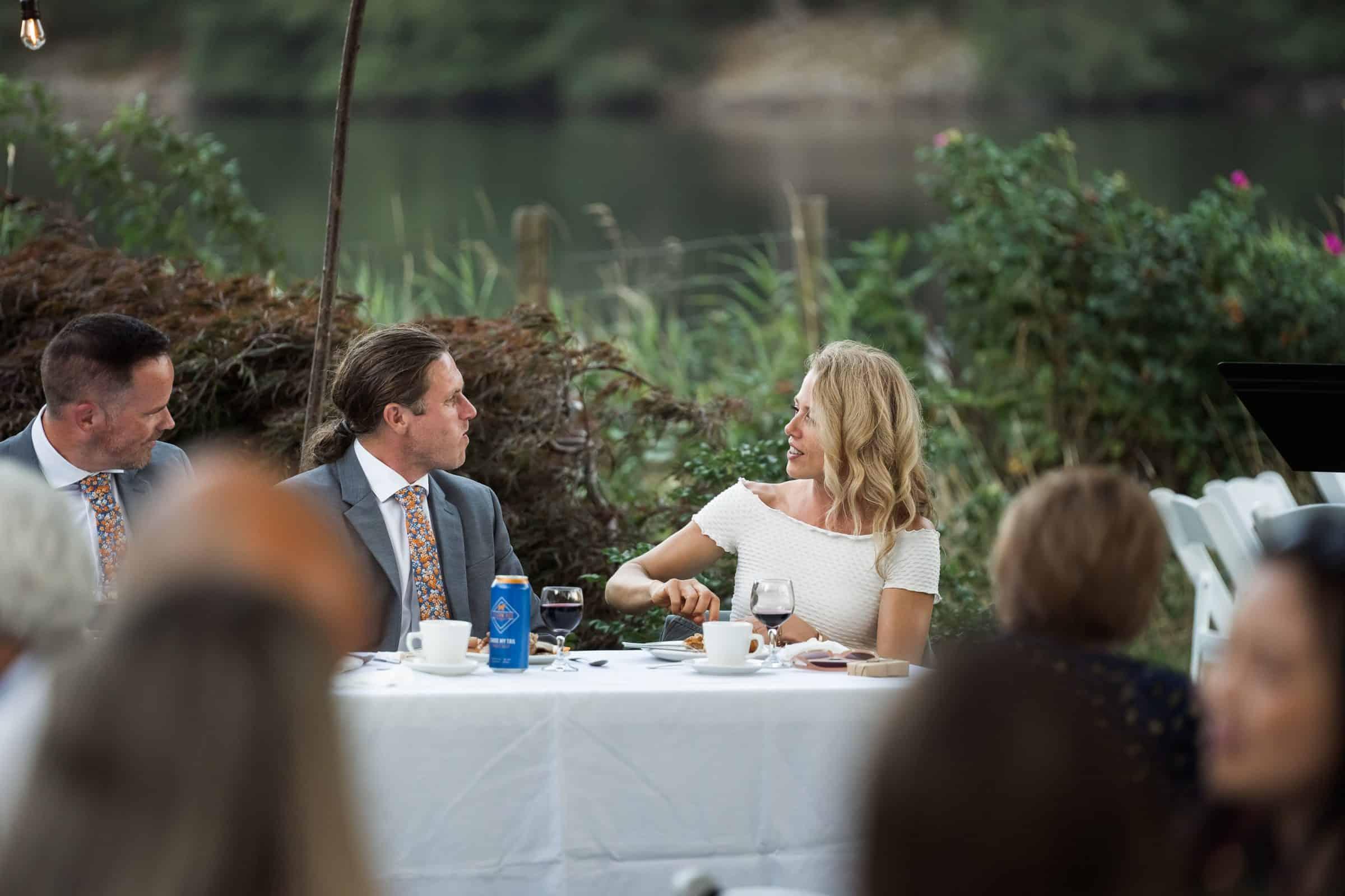 bridal party interacting at head table
