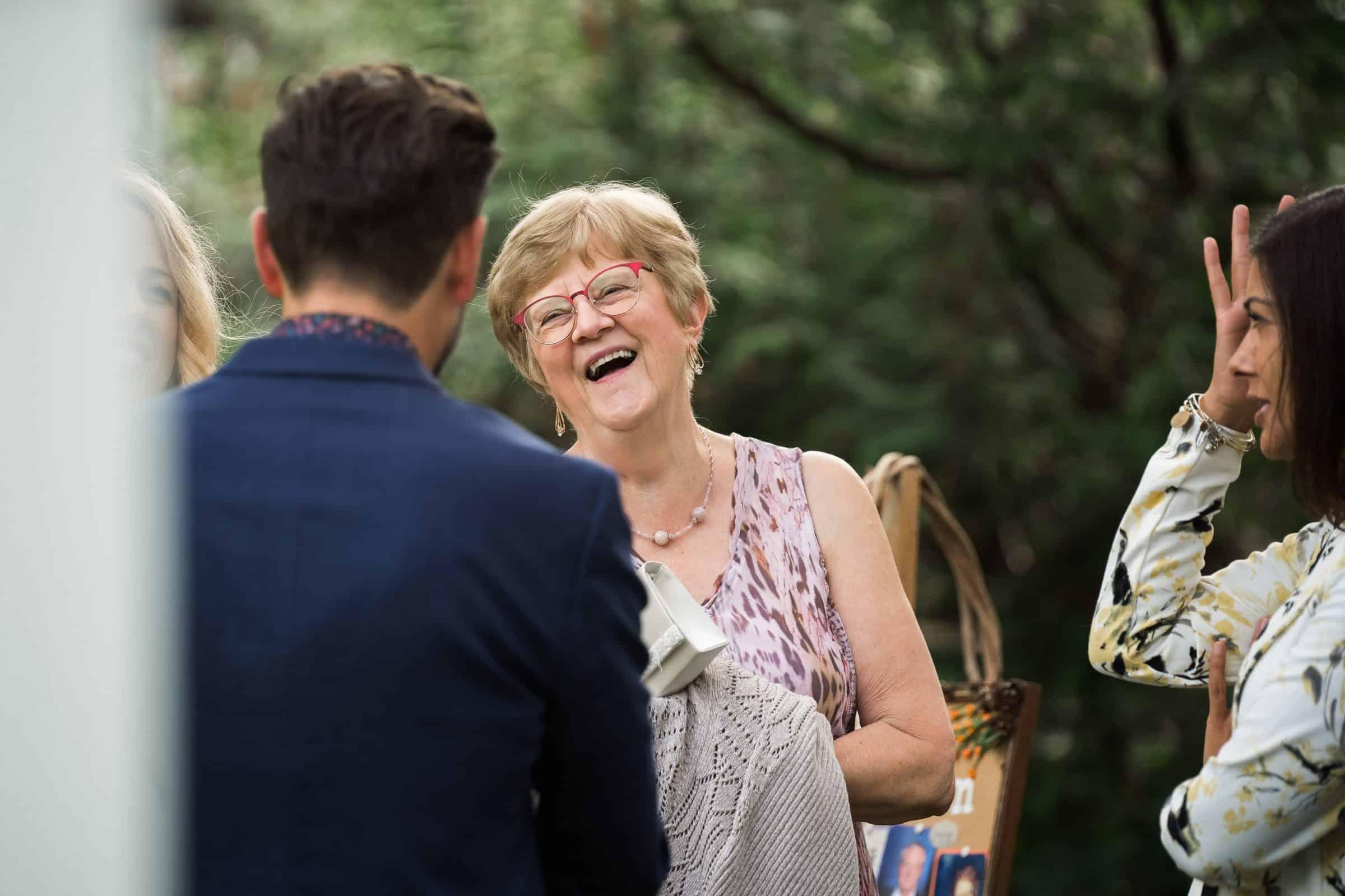 guest laughing at backyard wedding