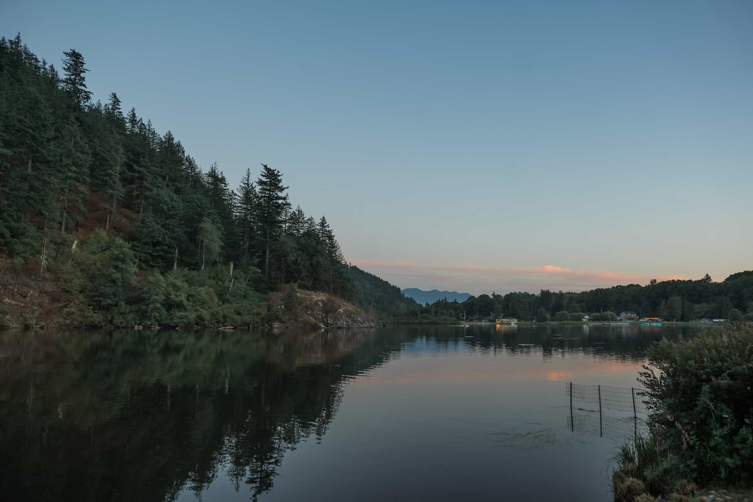 scenic shot of lake at sunset