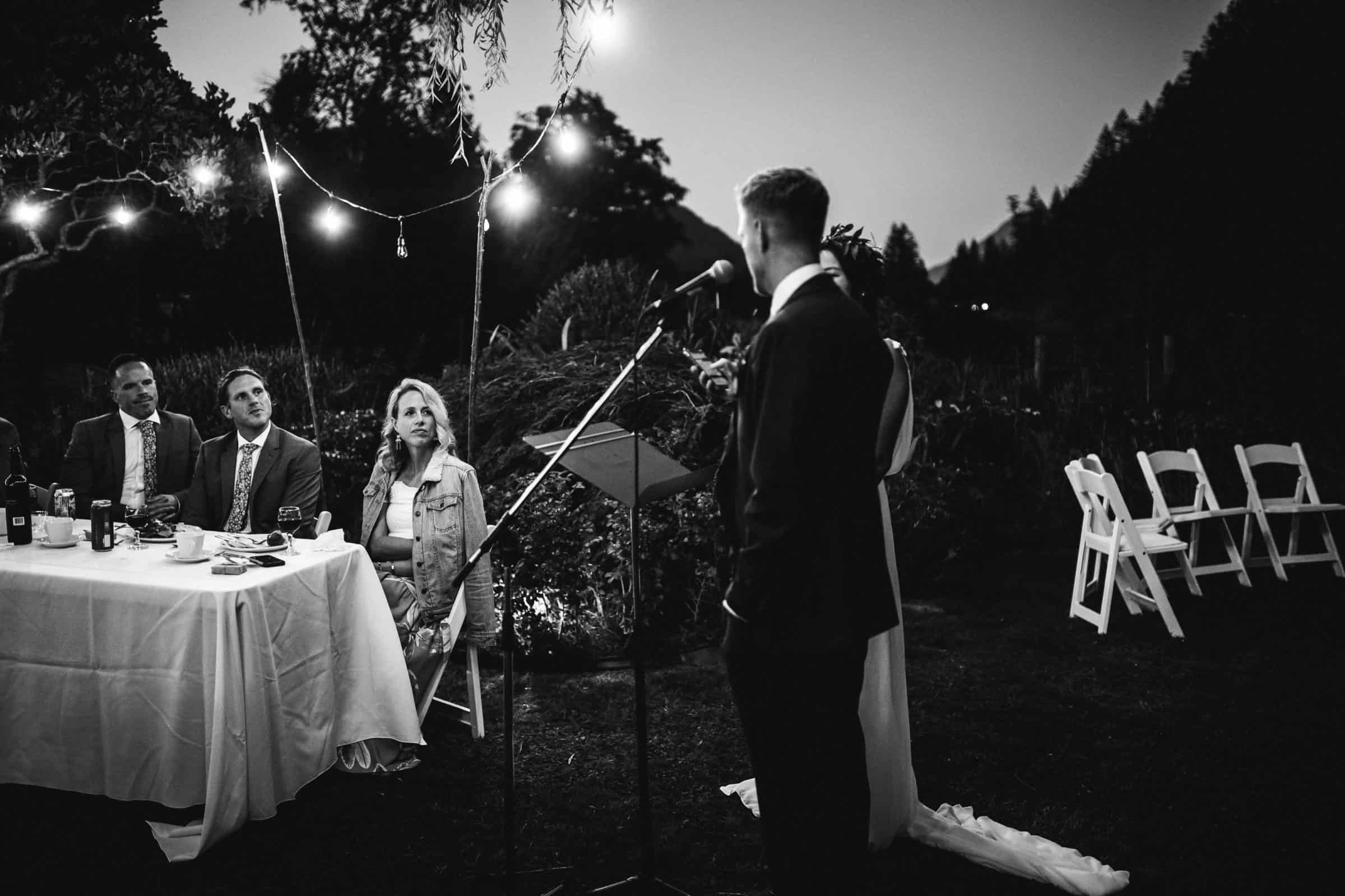 groom and bride giving speech with focus on groom's sister
