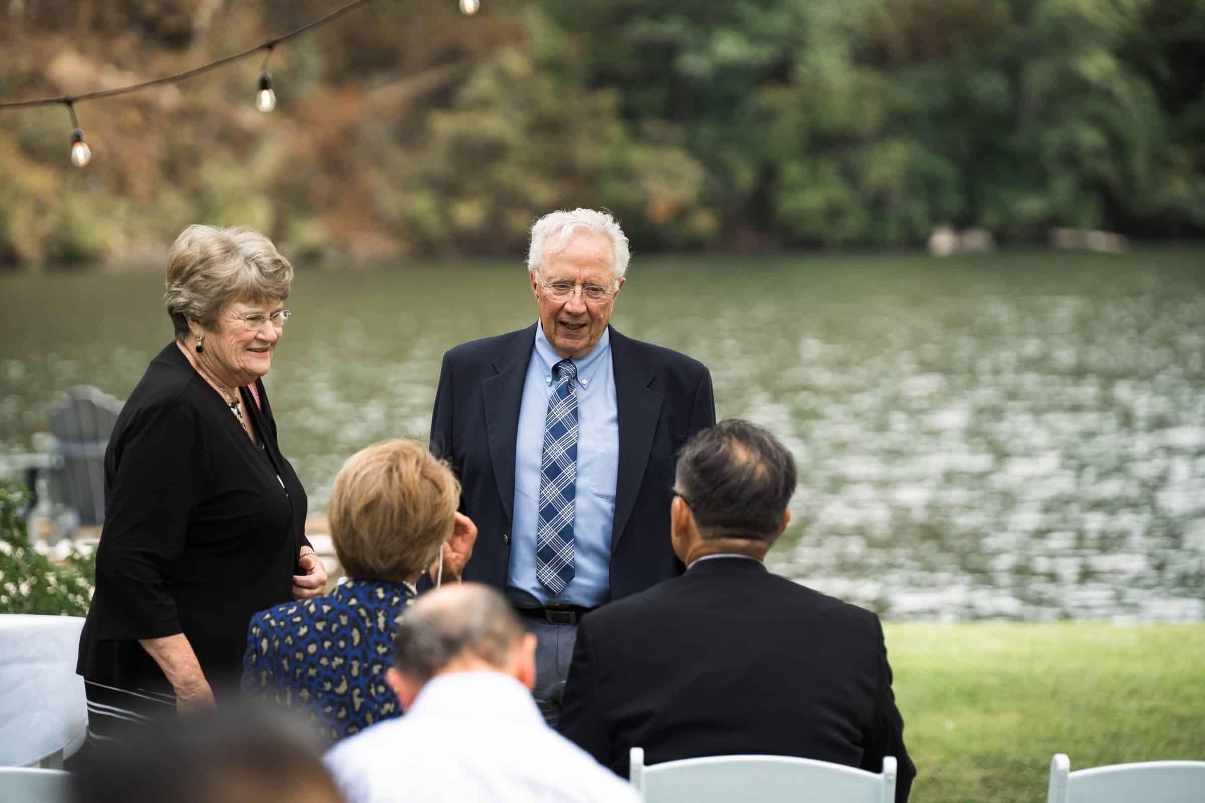 guests mingling at backyard wedding