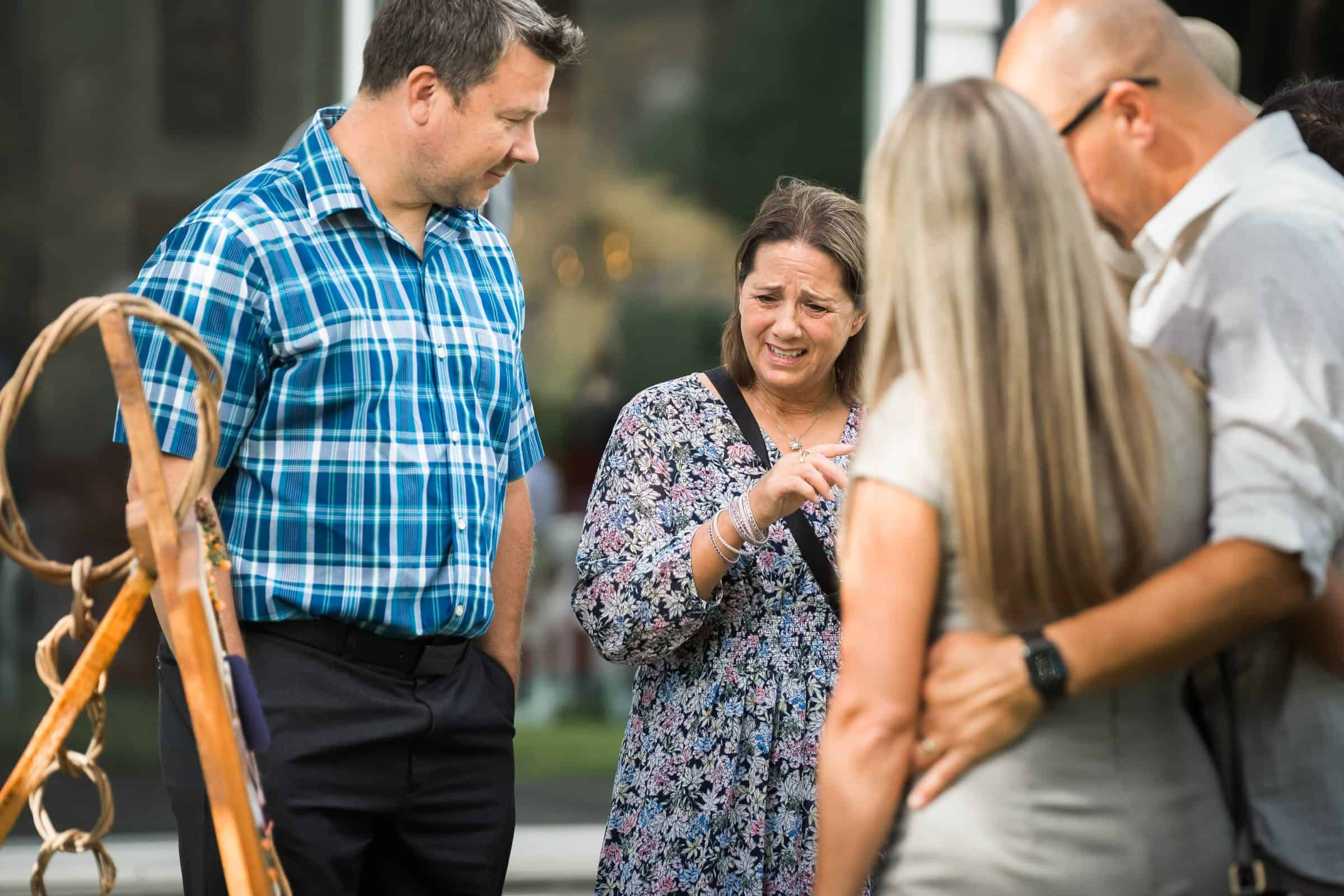 wedding guest crying at memorial sign